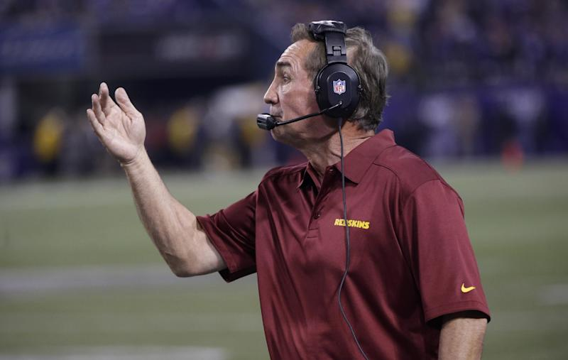 In this Nov. 7, 2013 photo, Washington Redskins head coach Mike Shanahan reacts during the second half of an NFL football game against the Minnesota Vikings in Minneapolis. (AP Photo/Jim Mone)