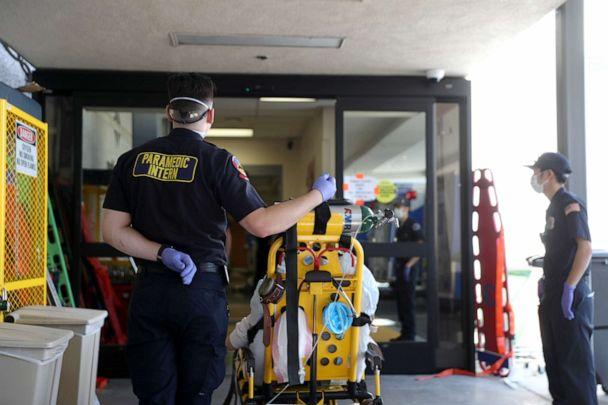 PHOTO: Paramedics wait to bring a patient into the emergency room at Regional Medical Center in San Jose, California, on May 21, 2020. (Justin Sullivan/Getty Images)