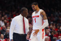 FILE - In this Dec. 14, 2019, file photo, Dayton head coach Anthony Grant, left, speaks with Obi Toppin (1) during the second half of an NCAA college basketball game against Drake, in Dayton, Ohio. Toppin and Grant have claimed top honors from The Associated Press after leading the Flyers to a No. 3 final ranking. Toppin was voted the AP men's college basketball player of the year. Grant is the AP coach of the year. (AP Photo/John Minchillo, File)