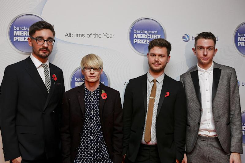 "FILE - In this Nov. 1, 2012 file photo, from left, Gus Unger-Hamilton, Gwil Sainsbury, Joe Newman and Thom Green of Alt-J attend the Barclaycard Mercury Prize 2012 at the Roundhouse, in London. Their debut album, ""An Awesome Wave,"" went on to win the prestigious Mercury Prize given to the top album of the year in the United Kingdom and Ireland. The Cambridge quartet has since been a near constant conversation piece on the blogosphere and mid-sized club circuit on both sides of the Atlantic Ocean. (AP Photo/Barclaycard Mercury Prize, Jon Furniss, File)"