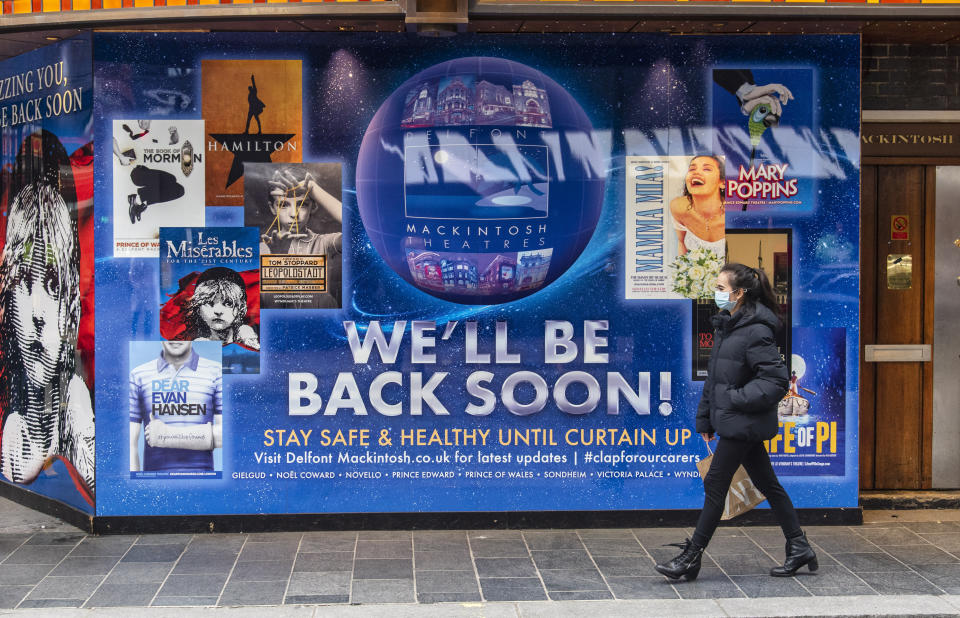 A woman wearing a face mask walks past a new signage with 'We'll be back soon' on the Sondheim theatre completed after Producer Cameron Mackintosh announced that Les Miserables is set to come back to London's West End by Christmas with tickets going on sale soon after having shut due to the UK entering lockdown. (Photo by Dave Rushen / SOPA Images/Sipa USA)