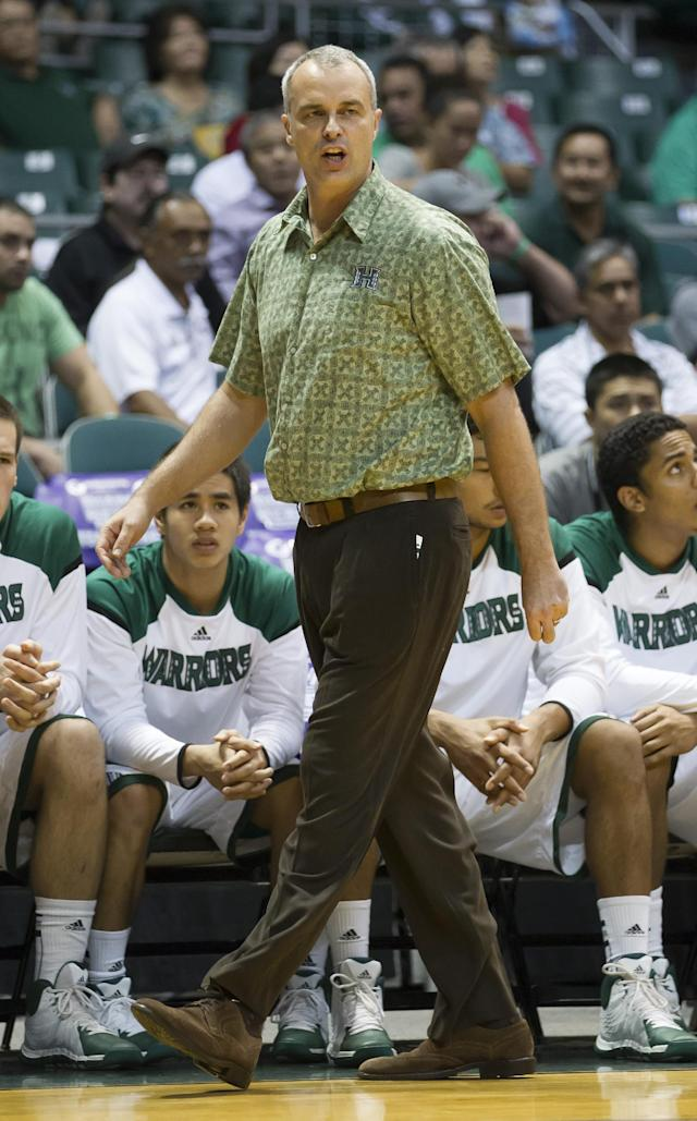 Hawaii head coach Gib Arnold watches his team play St. Mary's in the first half of an NCAA college basketball game at the Diamond Head Classic Monday, Dec. 23, 2013, in Honolulu. (AP Photo/Eugene Tanner)