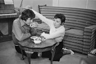<p><em>The Wizard of Oz</em> star Judy Garland and musician Mickey Deans enjoy a cup of tea on the floor of their London home the morning of their wedding, March 15, 1969.</p>