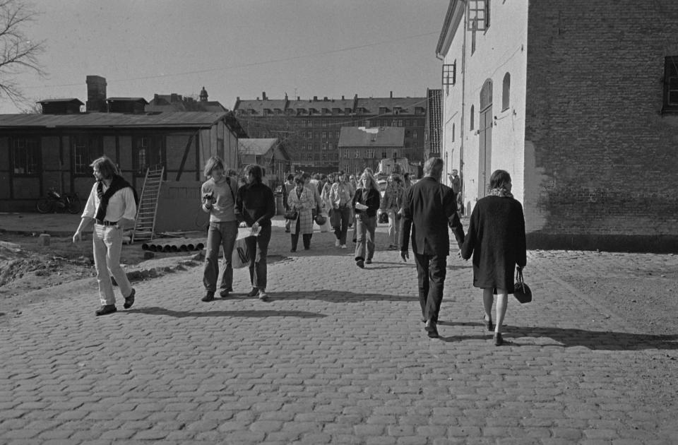 """FILE - In this 1974 file photo, people walk the streets of Christiania, In Copenhagen, Denmark. Copenhagen's Christiania neighborhood is turning 50 and after years of not always peaceful coexistence with the authorities, the counter-culture enclave wants to maintain its reputation as a """"free-wheeling society"""" of hash dealers, political idealists, and aging hippies. One resident says the oasis has"""" become more and more an established part"""" of the Danish capital. It all started in 1971, when a small counterculture newspaper needed an outrageous story for its front page and staged an """"invasion"""" of an abandoned 18-century navy base. (Jacob Maarbjerg/Ritzau Scanpix via AP, File)"""