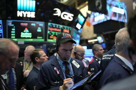 A trader wearing a Trump hat works at the New York Stock Exchange (NYSE) in Manhattan, New York City, U.S.