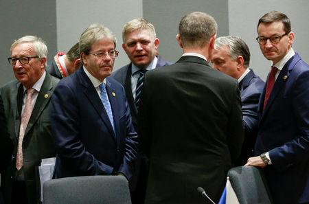 European Commission President Jean-Claude Juncker, Italian Prime Minister Paolo Gentiloni, Slovakia's Prime Minister Robert Fico, the Czech Republic's Prime Minister Andrej Babis, Hungarian Prime Minister Victor Orban and Polish Prime Minister Mateusz Morawiecki attend the Visegrad Group meeting in Brussels, Belgium, December 14, 2017. REUTERS/Olivier Hoslet/Pool
