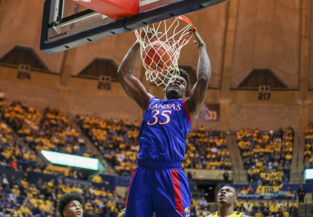Kansas Jayhawks center Udoka Azubuike (35) dunks the ball during the first half against the West Virginia Mountaineers at WVU Coliseum. (Ben Queen/USA TODAY Sports)