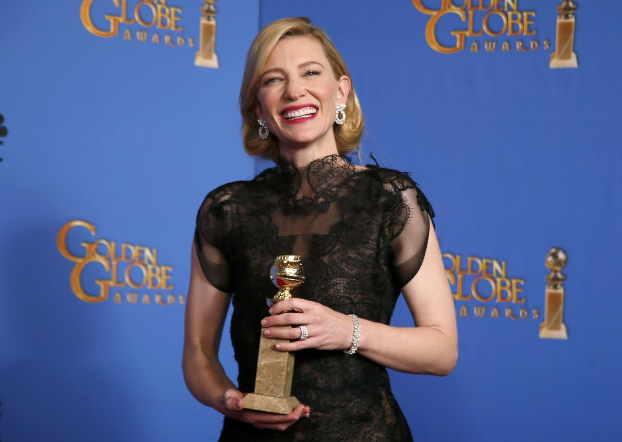 """Actress Cate Blanchett poses backstage with her Best Performance by an Actress in a Motion Picture - Drama Award for """"Blue Jasmine"""" at the 71st annual Golden Globe Awards in Beverly Hills"""
