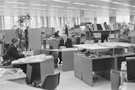 """<p>While open plans didn't gain speed until the 1980s, some offices began toiling with the idea and <a href=""""https://woodhouseworkspace.com/the-office-transformation-back-to-the-70s/"""" rel=""""nofollow noopener"""" target=""""_blank"""" data-ylk=""""slk:experimenting with open plans"""" class=""""link rapid-noclick-resp"""">experimenting with open plans</a> in the 1970s. </p>"""