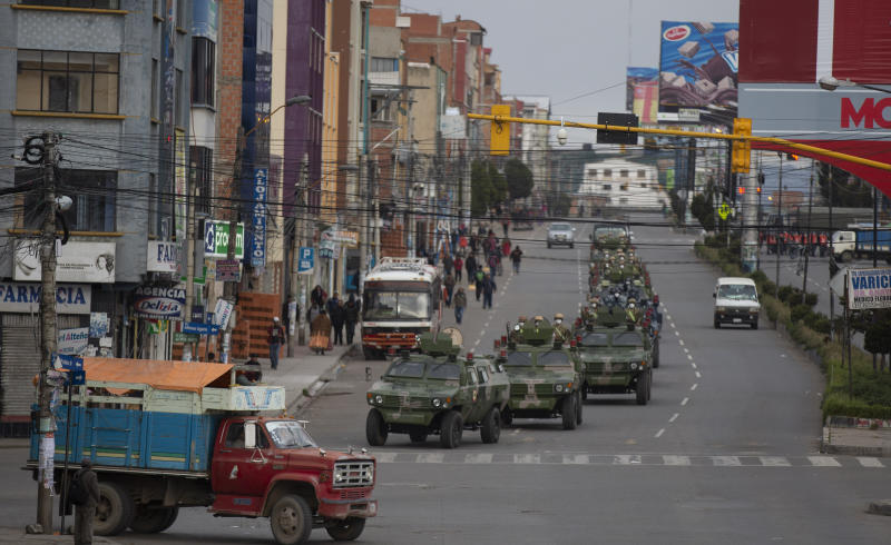 Military armored vehicles patrol the streets during a quarantine in El Alto, Bolivia, Friday, March 20, 2020. Authorities have decreed a quarantine from 5pm to 5am in an attempt to stop the spread of the new coronavirus. The vast majority of people recover from the COVID-19 disease. (AP Photo/Juan Karita)