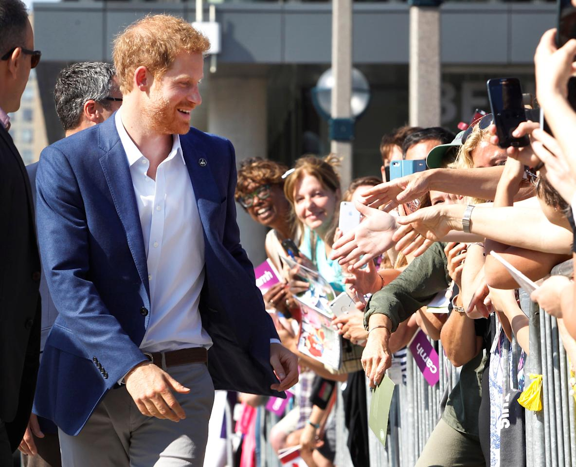 Patron of the Invictus Games Foundation, Prince Harry greets people outside CAMH The Centre for Addiction and Mental Health which he visited today prior to the opening of the Invictus Games this evening in Toronto, Ontario, Canada, September 23, 2017.  REUTERS/Fred Thornhill