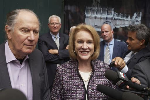 FILE - In this Oct. 2, 2018, file photo, Seattle Hockey Partners David Bonderman, left, and Seattle Mayor Jenny Durkan talk to the media as they leave a meeting at National Hockey League headquarters, in New York. The NHL Board of Governors is expected to vote to approve Seattle expansion at their two-day meeting and will get updates on collective bargaining talks and the concussion lawsuit settlement. (AP Photo/Mark Lennihan, File)