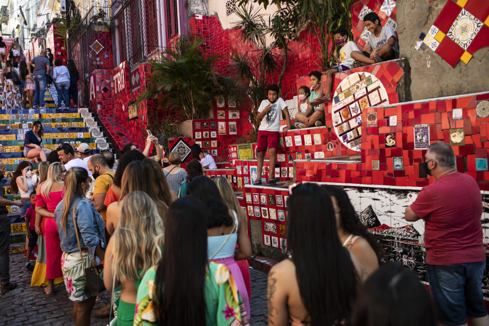 People line up to take their pictures on the Selaron Stairway in Rio de Janeiro, Brazil, Friday, July 23, 2021, during the COVID-19 pandemic. (AP Photo/Bruna Prado)