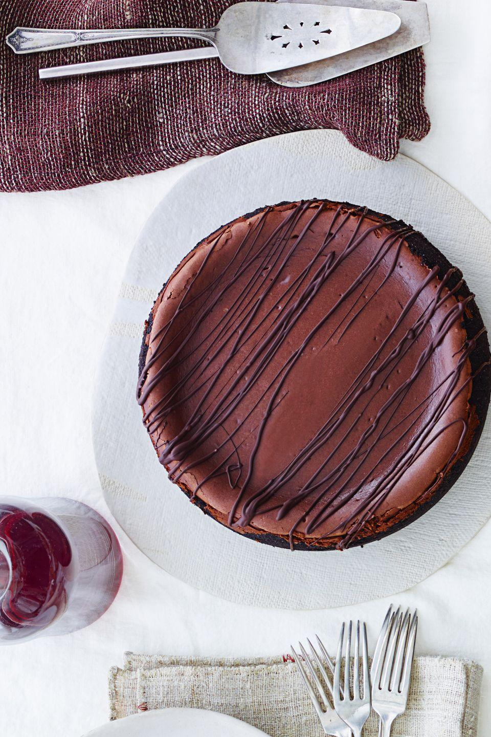 "<p>This indulgent cheesecake recipe is perfect for those who crave a little coffee with their sweet treats.</p><p><a href=""https://www.goodhousekeeping.com/food-recipes/a15895/midnight-mocha-cheesecake-recipe-ghk1114/"" rel=""nofollow noopener"" target=""_blank"" data-ylk=""slk:Get the recipe for Midnight Mocha Cheesecake »"" class=""link rapid-noclick-resp""><em>Get the recipe for Midnight Mocha Cheesecake »</em></a></p>"