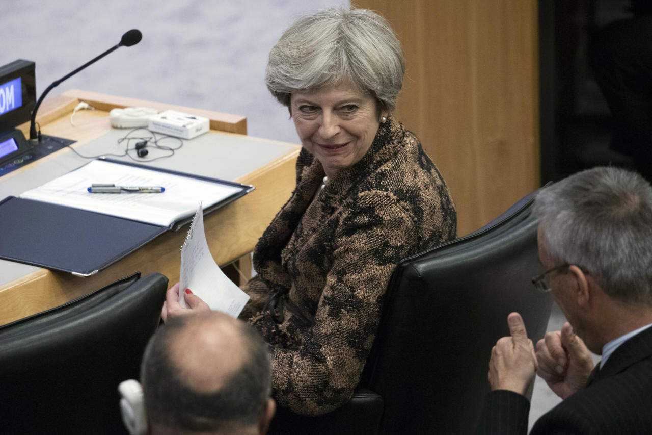 <p> British Prime Minister Theresa May speaks to an aid during a high level meeting on the situation in Libya, Wednesday, Sept. 20, 2017 at United Nations headquarters. (AP Photo/Mary Altaffer) </p>