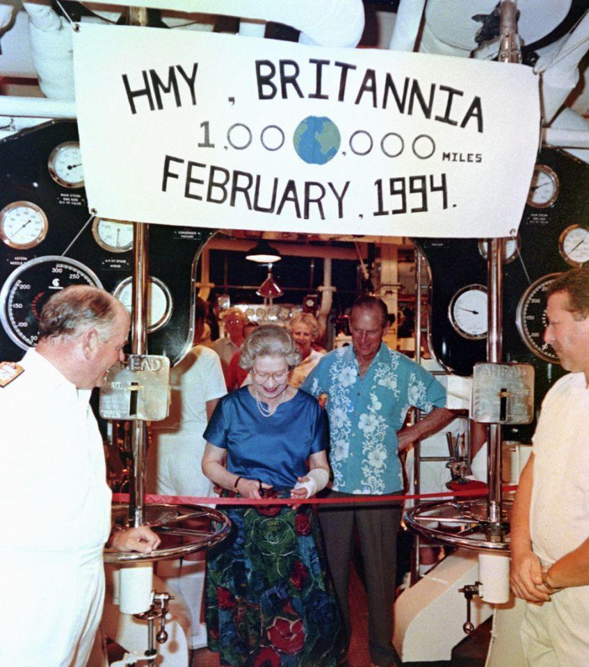 <p>Her Majesty Queen Elizabeth smiles as she cuts a ribbon in the engine of the Royal Yacht Britannia, to mark the ship's one millionth mile on the same engine. (PA Archive) </p>