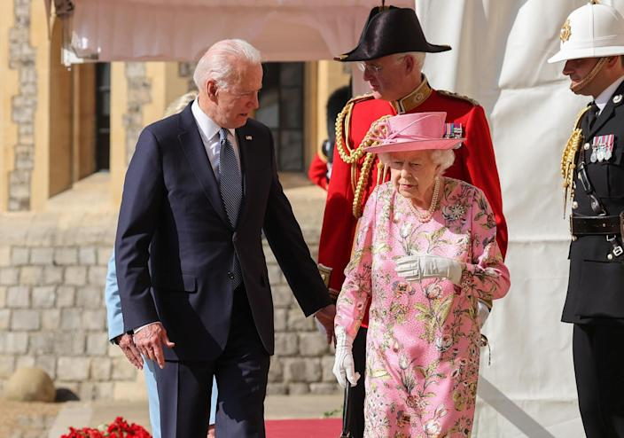 Britain's Queen Elizabeth walks with President Biden and first lady Jill Biden as they meet at Windsor Castle, on June 13, 2021. / Credit: POOL / REUTERS