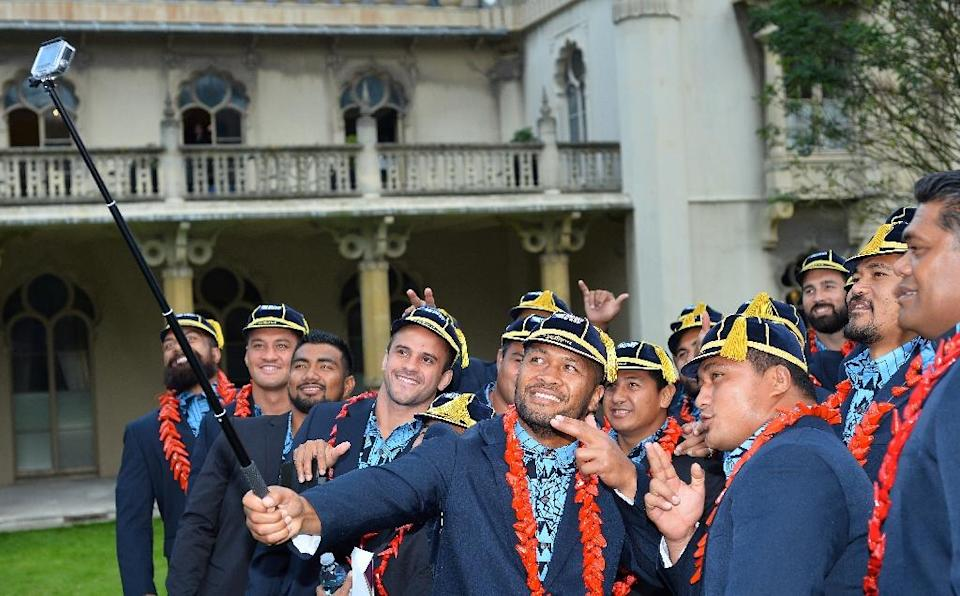 Members of the Samoan team take a selfie after a welcoming ceremony at the Royal Pavilion in Brighton on September 11, 2015 (AFP Photo/Glyn Kirk)