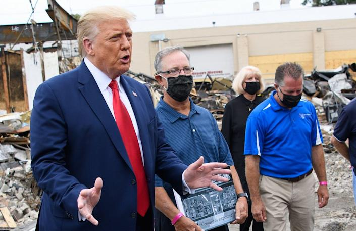 """<span class=""""caption"""">President Trump stressed law and order on a recent trip to Kenosha, Wisconsin.</span> <span class=""""attribution""""><a class=""""link rapid-noclick-resp"""" href=""""https://www.gettyimages.com/detail/news-photo/president-donald-trump-speaks-to-the-press-as-he-tours-an-news-photo/1228311852?adppopup=true"""" rel=""""nofollow noopener"""" target=""""_blank"""" data-ylk=""""slk:Mandel Ngan/AFP via Getty Images)"""">Mandel Ngan/AFP via Getty Images)</a></span>"""