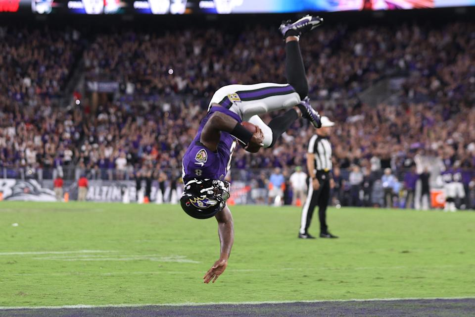 BALTIMORE, MARYLAND - SEPTEMBER 19: Lamar Jackson #8 of the Baltimore Ravens flips into the endzone for a touchdown against the Kansas City Chiefs during the fourth quarter at M&T Bank Stadium on September 19, 2021 in Baltimore, Maryland. (Photo by Rob Carr/Getty Images)