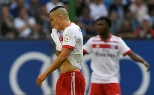 Soccer Football - Bundesliga - Hamburger SV v Borussia Moenchengladbach - Volksparkstadion, Hamburg, Germany - May 12, 2018 Hamburg's Bobby Wood looks dejected as he walks off after being shown a red card REUTERS/Fabian Bimmer DFL RULES TO LIMIT THE ONLINE USAGE DURING MATCH TIME TO 15 PICTURES PER GAME. IMAGE SEQUENCES TO SIMULATE VIDEO IS NOT ALLOWED AT ANY TIME. FOR FURTHER QUERIES PLEASE CONTACT DFL DIRECTLY AT + 49 69 650050