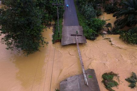 A bridge damaged by floods is pictured at Chai Buri District, Surat Thani province, southern Thailand, January 9, 2016. Picture taken January 9, 2016. Dailynews/ via REUTERS