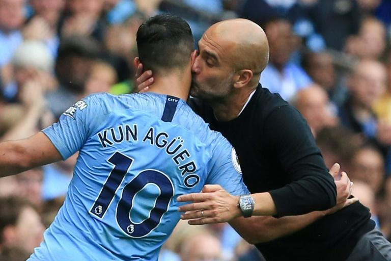 Manchester City manager Pep Guardiola kisses Sergio Aguero after he scored a hat-trick in 2018