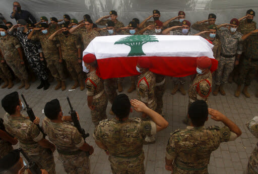 Show of solidarity after blast as Lebanon braces for protest