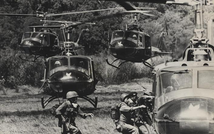Vietnamese soldiers being picked up by an American Army turbo-jet helicopters after completing an operation against Communist guerillas in a mountamous jungle area of South Vietnam. - AP
