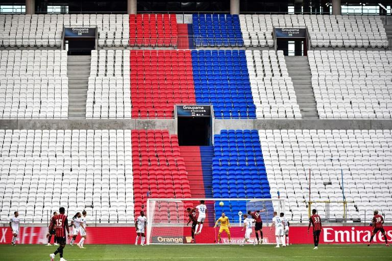 Quiet return: Lyon and Nice played a friendly in as empty stadium (AFP Photo/JEFF PACHOUD)