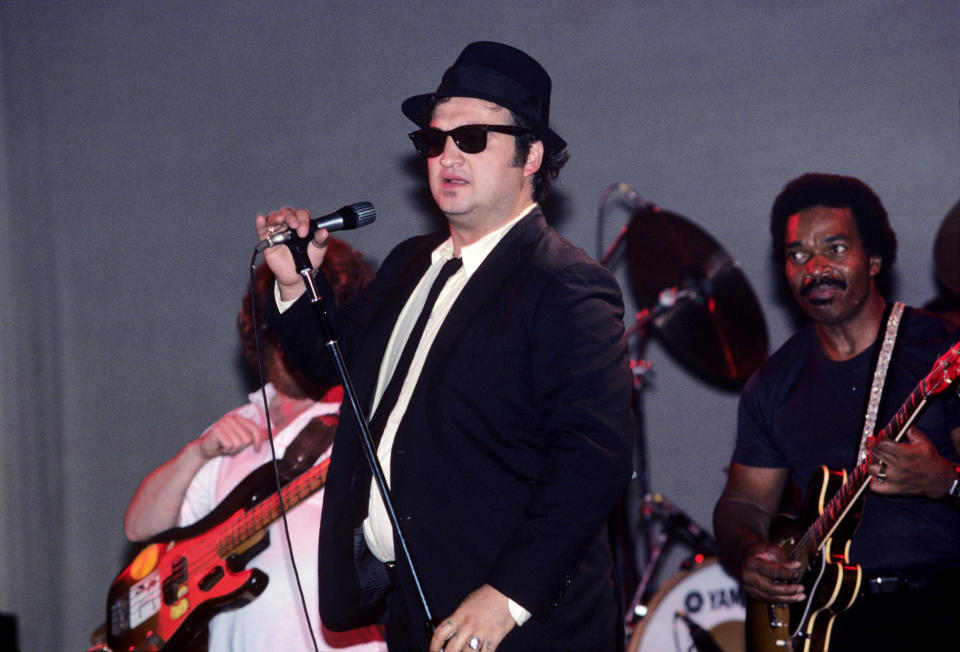 (MANDATORY CREDIT Ebet Roberts/Getty Images) John Belushi with Donald Duck Dunn and Matt 'Guitar' Murphy in back performing with The Blues Brothers at the Palladium in New York City on June 1, 1980. (Photo by Ebet Roberts/Redferns)