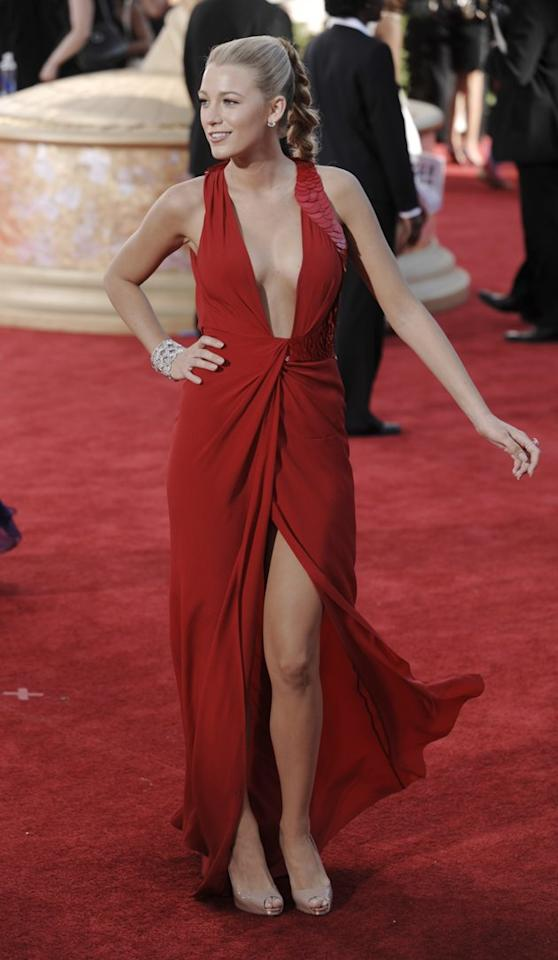 """BEST: """"Gossip Girl"""" Blake Lively rocks a plunging neckline in a red Versace dress at the 2009 Emmy Awards. (AP Photo/Chris Pizzello)"""