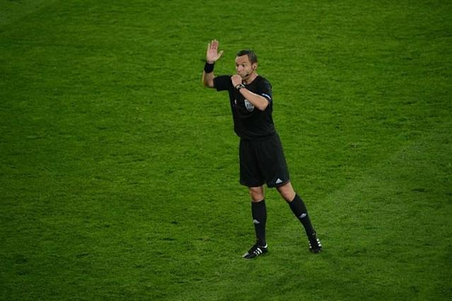 French referee Stephane Lannoy whistles during the Euro 2012 championships football match Germany vs Portugal on June 9, 2012 at the Arena Lviv. AFP PHOTO / ANNE-CHRISTINE POUJOULATANNE-CHRISTINE POUJOULAT/AFP/GettyImages