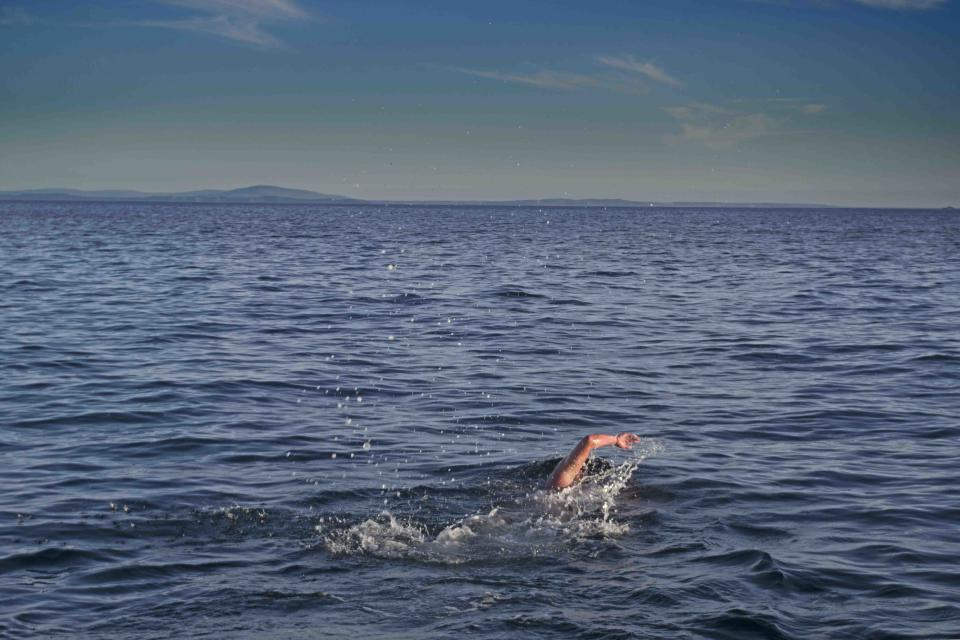 The swimmers became the first to conquer the Oa Channel from Islay in Scotland to the Giant's Causeway in Northern Ireland (Colin Lindsay/PA)