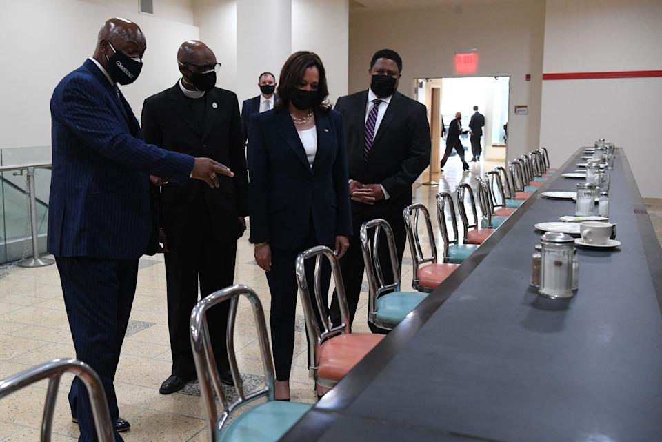 Harris is shown the once-segregated lunch counter from the original Woolworth's building as she visits Greensboro, North Carolina, on Monday. (Photo: SAUL LOEB via Getty Images)