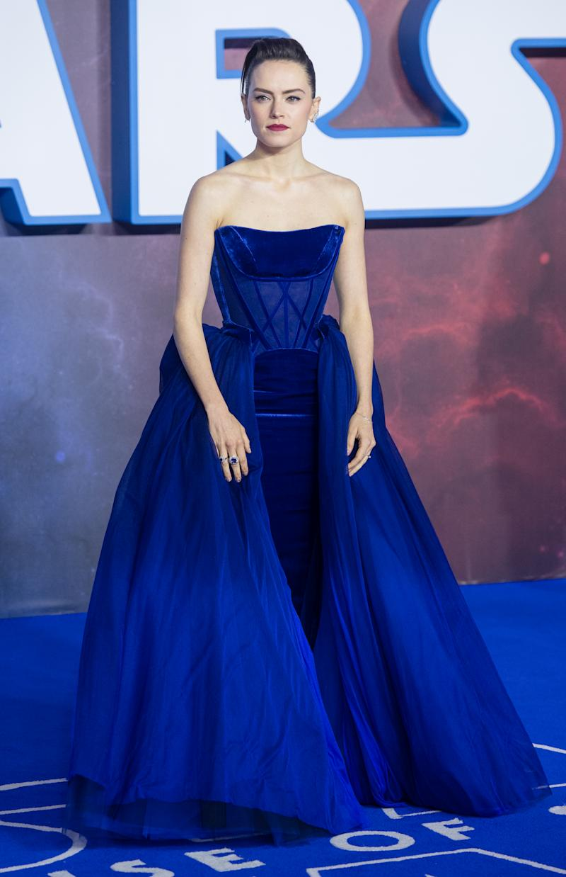 Ridley wears a Vivienne Westwood Couture dress to the London premiere of 'Star Wars: The Rise of Skywalker' [Photo: Getty]