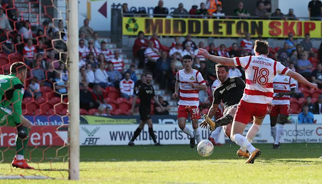 "Soccer Football - League One - Doncaster Rovers vs Wigan Athletic - Keepmoat Stadium, Doncaster, Britain - May 5, 2018 Wigan Athletic's Will Grigg shoots at goal Action Images/John Clifton EDITORIAL USE ONLY. No use with unauthorized audio, video, data, fixture lists, club/league logos or ""live"" services. Online in-match use limited to 75 images, no video emulation. No use in betting, games or single club/league/player publications. Please contact your account representative for further details."