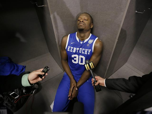 Kentucky forward Julius Randle is interviewed in the locker room after his team's 60-54 loss to Connecticut in the NCAA Final Four tournament college basketball championship game Monday, April 7, 2014, in Arlington, Texas. (AP Photo/Eric Gay)