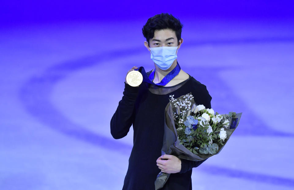 Nathan Chen of the USA stands on the podium after winning the gold medal during the Men Free Skating Program at the Figure Skating World Championships in Stockholm, Sweden, Saturday, March 27, 2021. (AP Photo/Martin Meissner)