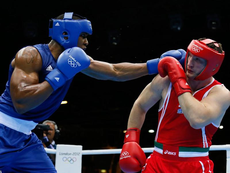 Where it all started: Joshua in action during his 2012 Gold Olympic fight against Roberto Cammarelle (Getty)