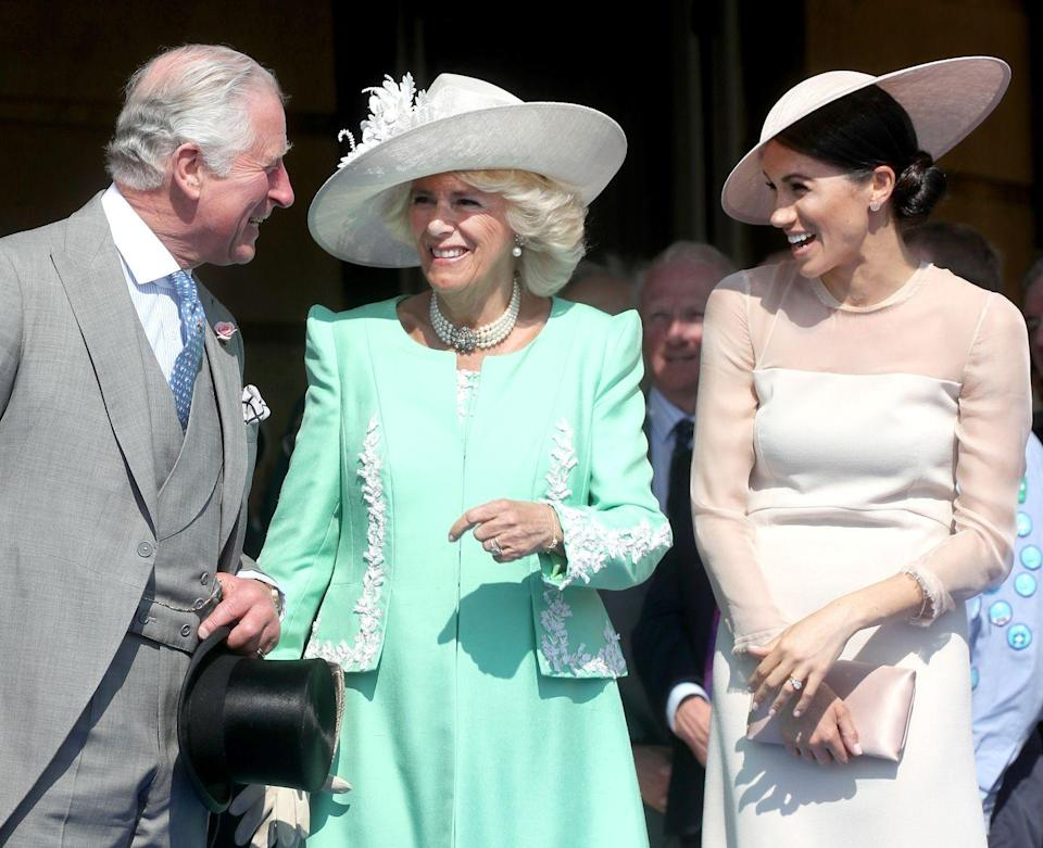 <p>Meghan Markle's first official post-wedding appearance as the Duchess of Sussex was at a garden party at Buckingham Palace in celebration of Prince Charles's 70th birthday. This sweet snap captured Meghan chatting with her new in-laws.</p>