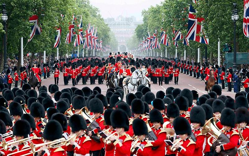 Guardsmen parade down the Mall towards Buckingham Palace after attending the Trooping the Colour ceremony at Horse Guards Parade in central London in 2015 - Credit: Stefan Wermuth /Reuters