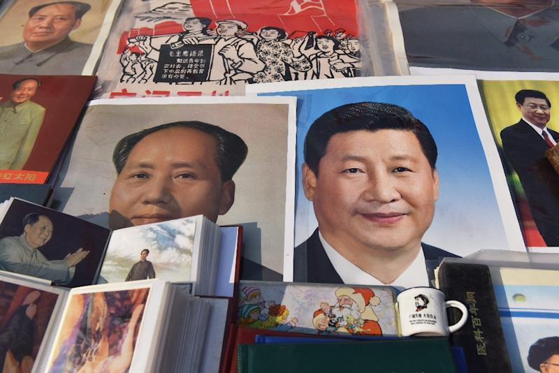 Xi Jinping's (R) tightening grip on China had already earned the leader comparisons to Mao Zedong, but they came into even sharper focus after the party paved the way for him to assume the presidency indefinitely