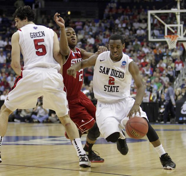 San Diego State's Xavier Thames, right, drives to the basket as teammate Garrett Green, left, sets a pick on NC State's Lorenzo Brown during the first half of an NCAA college basketball tournament second-round game Friday, March 16, 2012, in Columbus, Ohio. (AP Photo/Jay LaPrete)