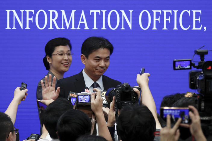 Yang Guang, spokesman of the Hong Kong and Macau Affairs Office of the State Council, gestures as reporters approach him after a press conference about the ongoing protests in Hong Kong, at the State Council Information Office in Beijing, Monday, July 29, 2019. Yang said some Western politicians are stirring unrest in Hong Kong in hopes of creating difficulties that will impede China's overall development. (AP Photo/Andy Wong)
