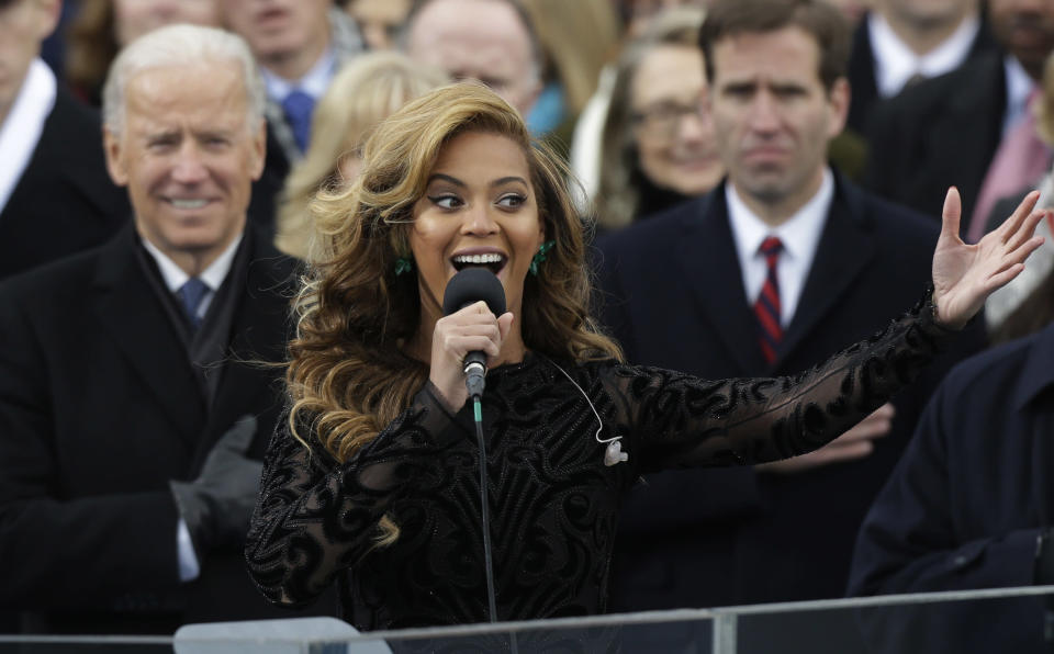 FILE - Beyonce sings the national anthem at the ceremonial swearing-in at the U.S. Capitol during the 57th Presidential Inauguration on Jan. 21, 2013, in Washington. A-list celebrities are flocking back to inaugural events four years after many stayed away from the inauguration of Donald Trump, hugely unpopular in Hollywood. (AP Photo/Pablo Martinez Monsivais, File)