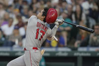 Los Angeles Angels' Shohei Ohtani strikes out swinging during the fifth inning of the team's baseball game against the Seattle Mariners, Friday, July 9, 2021, in Seattle. (AP Photo/Ted S. Warren)