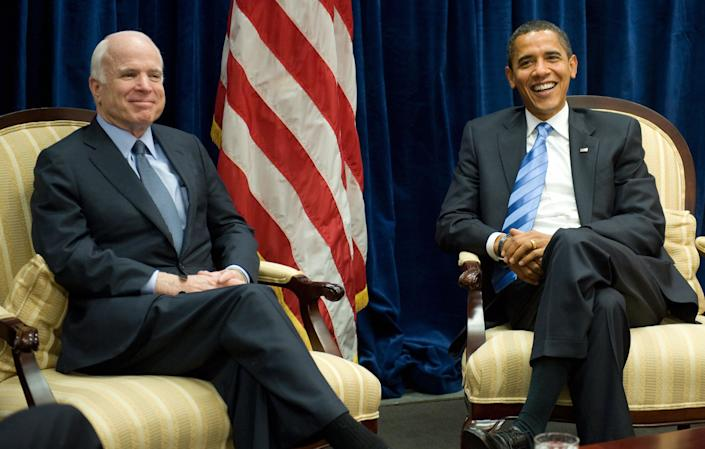 Barack Obama, at the time the president-elect of the U.S., meets with his former GOP rival McCain at Obama's transition offices in Chicago on Nov. 17, 2008.