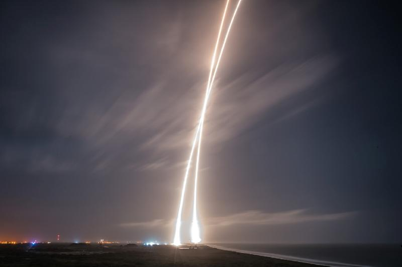 This image obtained courtesy of  SpaceX shows the first-stage successful upright launch and landing of the SpaceX  Falcon 9 rocket on December 21, 2015 at Cape Canaveral, a historic first in the company's bid to make rockets as reusable as airplanes