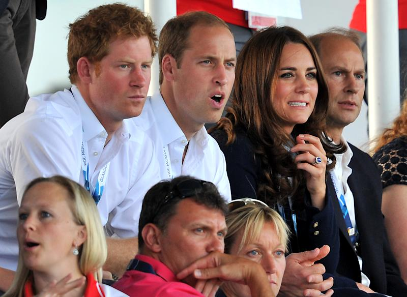 (L-R) Britain's Prince Harry, Prince William and his wife Kate, watch the women's field hockey match between Wales and Scotland during the Commonwealth Games in Glasgow on July 28, 2014
